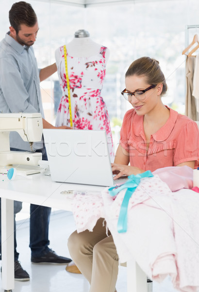 Woman using laptop with fashion designer working at studio Stock photo © wavebreak_media