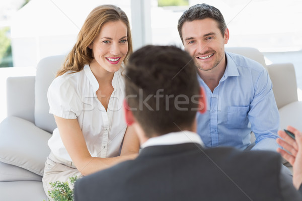 Smiling couple in meeting with a financial adviser Stock photo © wavebreak_media