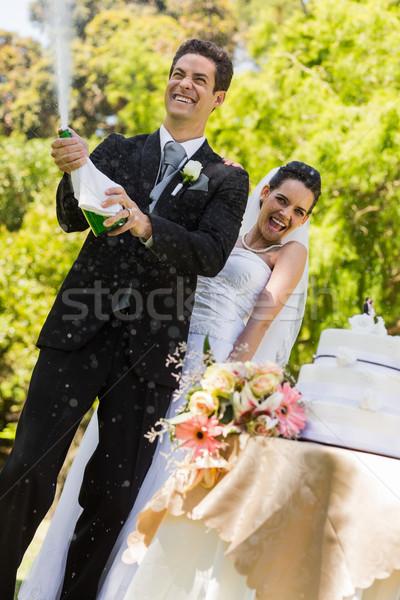 новобрачный пару жених открытие шампанского бутылку Сток-фото © wavebreak_media