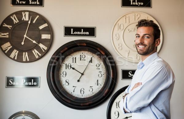 Feliz empresário em pé parede internacional Foto stock © wavebreak_media