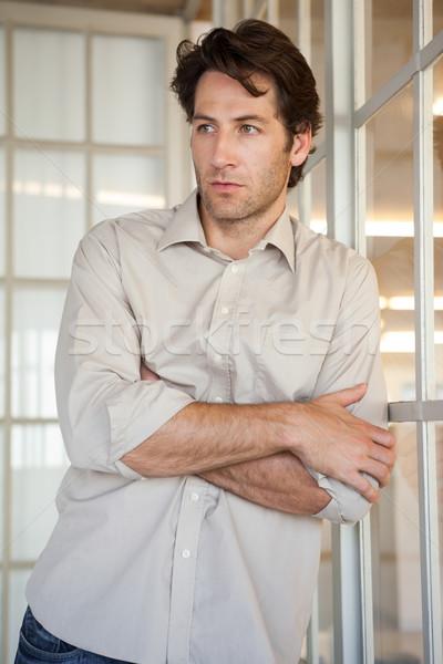 Casuale imprenditore finestra ufficio Foto d'archivio © wavebreak_media