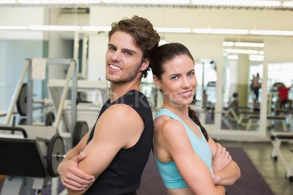 Stockfoto: Geschikt · aantrekkelijk · paar · glimlachend · camera · gymnasium