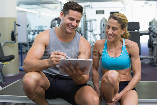 Female bodybuilder sitting with personal trainer talking Stock photo © wavebreak_media