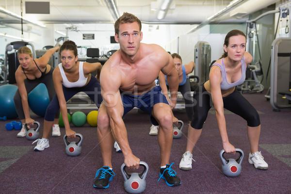 Muscolare istruttore kettlebell classe palestra Foto d'archivio © wavebreak_media