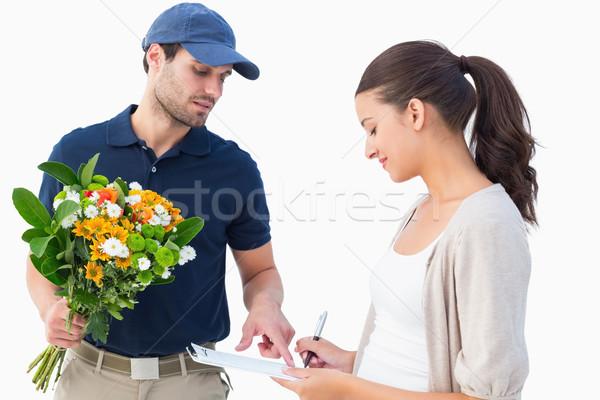 Feliz flor mensajero cliente blanco trabajo Foto stock © wavebreak_media