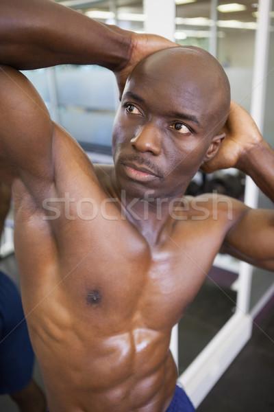 рубашки мышечный человека позируют спортзал Сток-фото © wavebreak_media