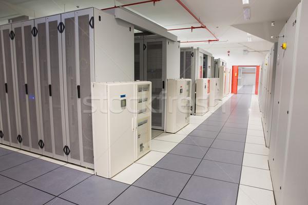 Empty hallway of server towers Stock photo © wavebreak_media