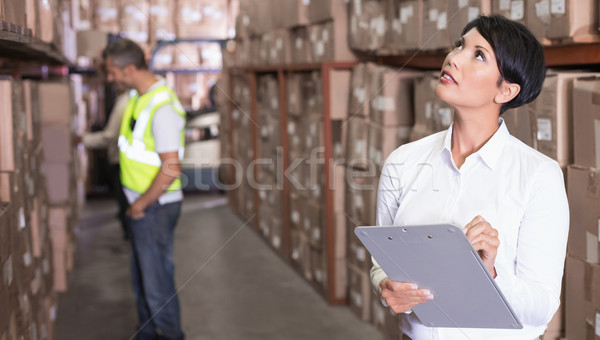Pretty warehouse manager checking inventory Stock photo © wavebreak_media