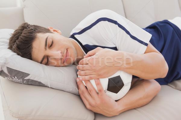 Futebol ventilador adormecido bola sofá Foto stock © wavebreak_media
