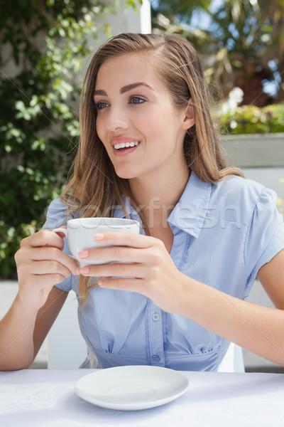 Beautiful woman having a coffee  Stock photo © wavebreak_media