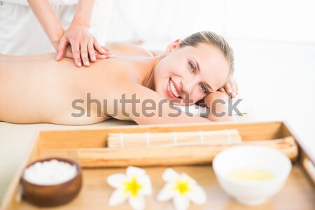 Stock photo: Woman receiving back massage at spa center