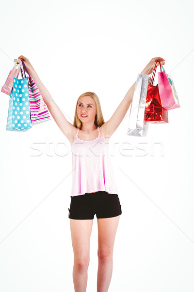 Pretty young blonde holding shopping bags Stock photo © wavebreak_media