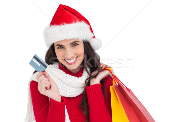 Excited brunette holding shopping bags and credit card  Stock photo © wavebreak_media