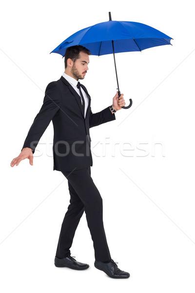 Zagęszczony biznesmen parasol strony niebieski Zdjęcia stock © wavebreak_media
