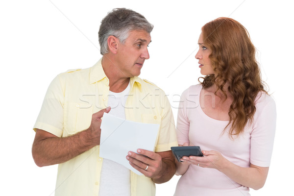 Casual couples working out their bills Stock photo © wavebreak_media