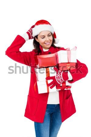 Brunette in red hat holding a gift Stock photo © wavebreak_media