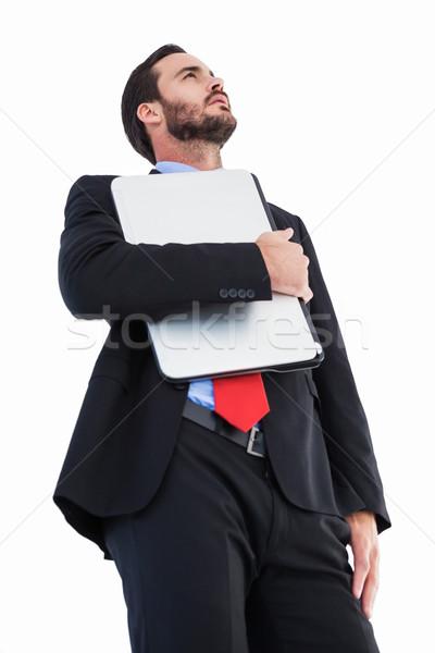 Concentrating businessman in suit holding laptop Stock photo © wavebreak_media