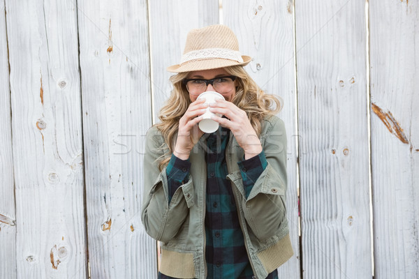 Portrait of blonde drinking from disposable cup Stock photo © wavebreak_media