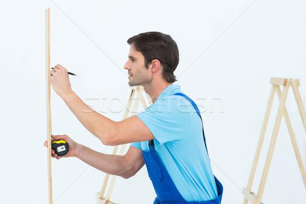 Carpenter marking on wood Stock photo © wavebreak_media