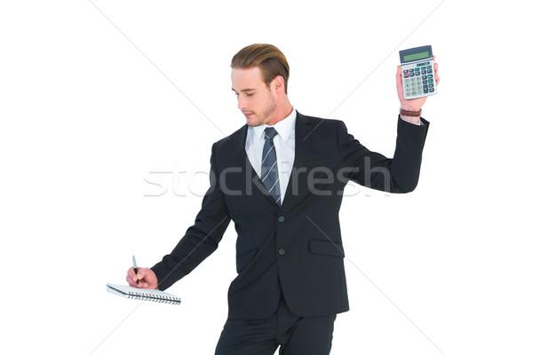 Ernstig zakenman calculator witte Stockfoto © wavebreak_media