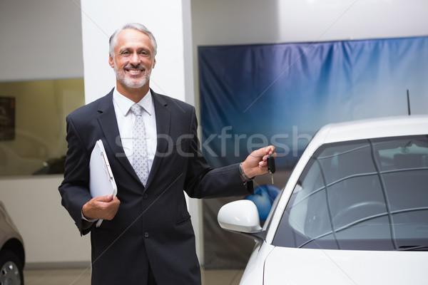 Sorridente empresário dobrador Foto stock © wavebreak_media