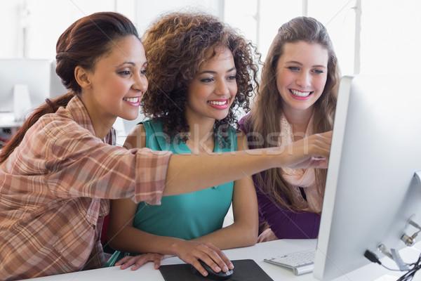 Students working in computer room Stock photo © wavebreak_media
