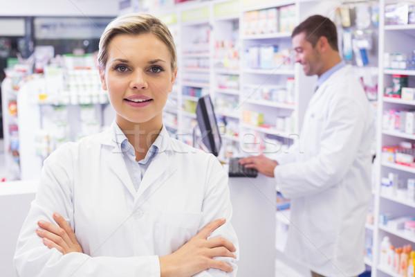 улыбаясь фармацевт Постоянный аптека женщину Сток-фото © wavebreak_media