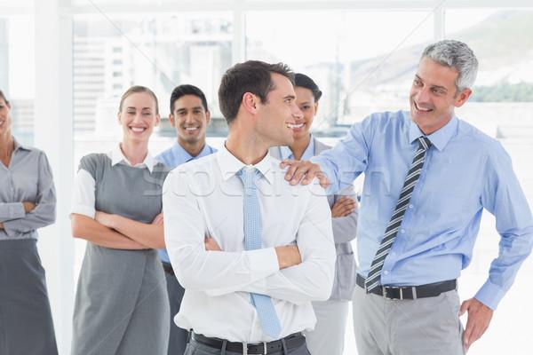 Businessman congratulating his colleagues  Stock photo © wavebreak_media