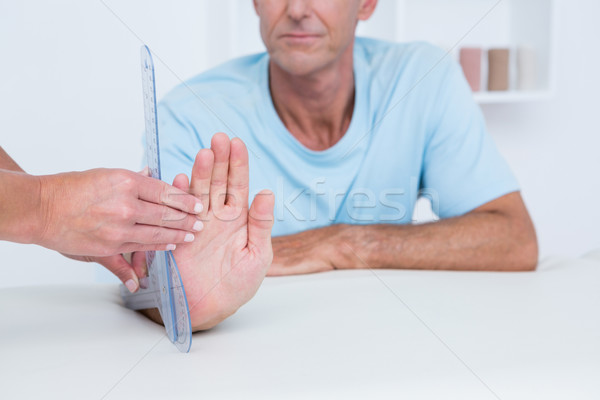 Doctor measuring wrist with goniometer  Stock photo © wavebreak_media