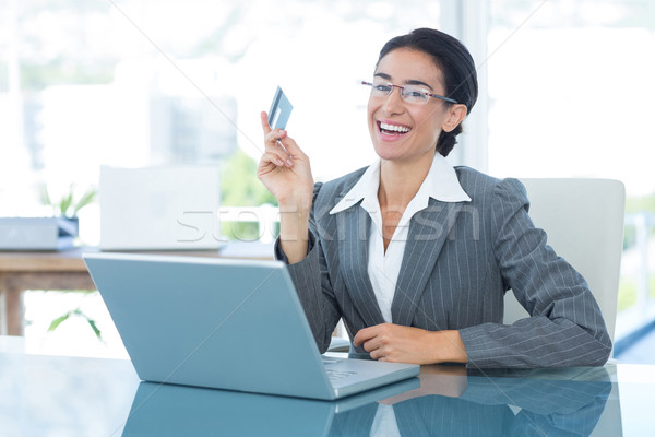Businesswoman doing online shopping in office Stock photo © wavebreak_media