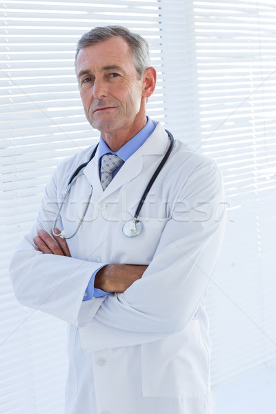 Confident male doctor looking at camera with arms crossed Stock photo © wavebreak_media