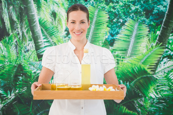 Smiling beauty therapist holding tray of beauty treatments Stock photo © wavebreak_media
