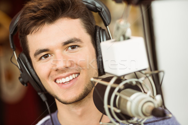 Portrait of an university student recording audio Stock photo © wavebreak_media