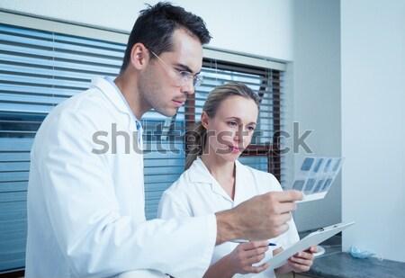 Dwa naukowcy patrząc pojemnik fabryki człowiek Zdjęcia stock © wavebreak_media