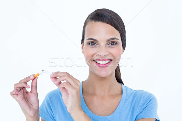 Happy woman breaking a cigarette Stock photo © wavebreak_media