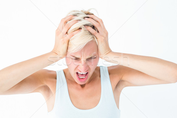 Angry blonde woman screaming and holding her head  Stock photo © wavebreak_media