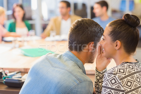 Casual businesswoman whispering secret to her colleague Stock photo © wavebreak_media