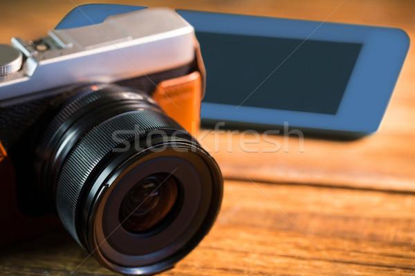 A beautiful brown fashioned camera next smartphone Stock photo © wavebreak_media