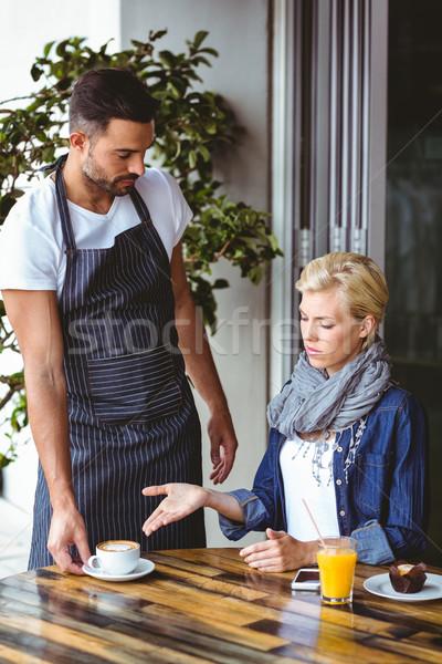 Pretty blonde arguing with the waiter Stock photo © wavebreak_media