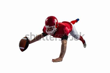 American football player reaching football Stock photo © wavebreak_media