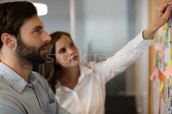 Serious businessman analyzing charts with female colleague Stock photo © wavebreak_media