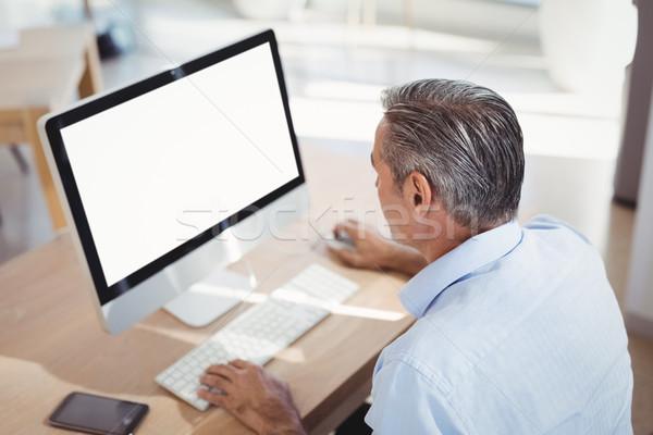 внимательный исполнительного рабочих персональный компьютер столе служба Сток-фото © wavebreak_media