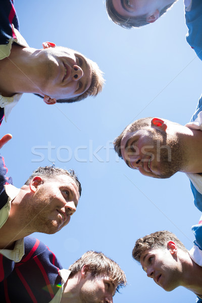 Low angle view of rugby players making huddle Stock photo © wavebreak_media