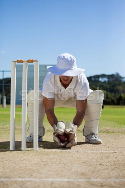 Full length of wicketkeeper holding ball behind stumps Stock photo © wavebreak_media