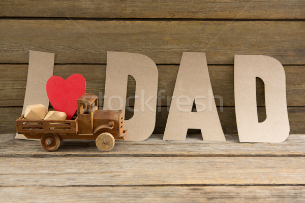 Close up of dad text by heart shape in toy truck Stock photo © wavebreak_media