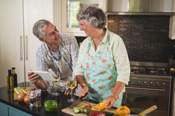 Smiling senior couple looking at each other while standing in kitchen Stock photo © wavebreak_media