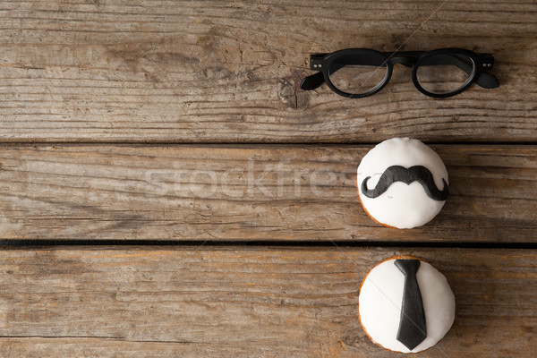 Delicious creative cupcakes and spectacles on wooden plank Stock photo © wavebreak_media