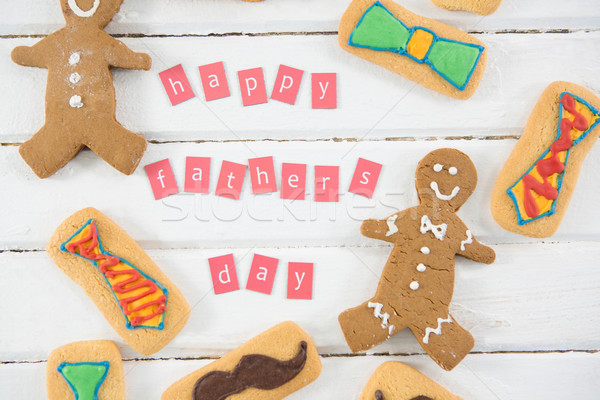 Overhead view of happy fathers day text by cookies on table Stock photo © wavebreak_media