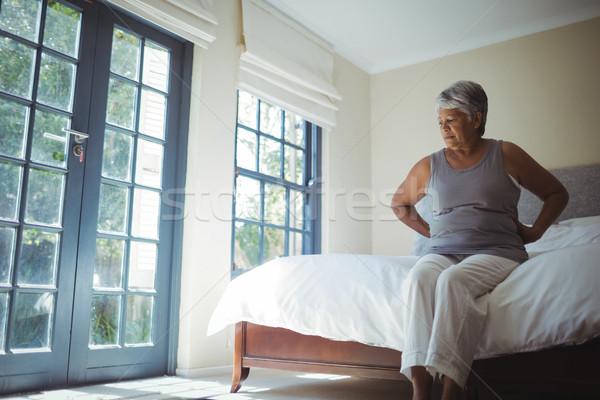 Senior mulher sofrimento dor nas costas casa sessão Foto stock © wavebreak_media