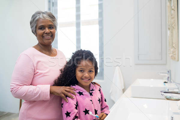 Smiling granddaughter and grandmother standing in bathroom Stock photo © wavebreak_media